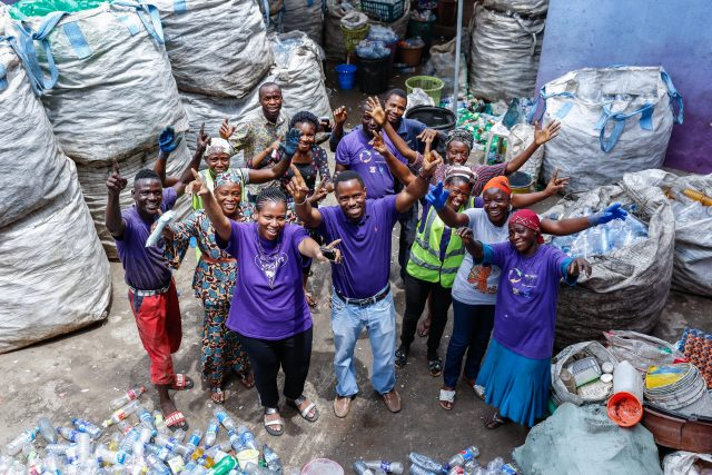 WeCyclers founders Olawale Adebiyi and Biliks Adebiyi-Abiola pose for a photograph with their team at the WeCyclers headquarters in Lagos Island, Lagos, Nigeria on Thursday 14th March 2019.